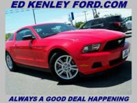 Check out this Sporty Red Mustang. Please call Jason
