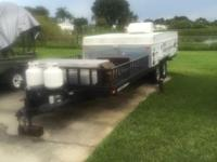 28' pop up toy hauler. Will hold 2 atv's or 1 golf cart