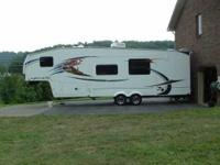 2012 Forest River Wildcat 311THX Toy Hauler. This 31