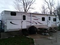 For sale is a 2012 Conquest Supreme 323-TBR ....with a
