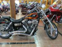And in the back the Harley Wide Glide features a side