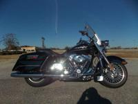 Big and commanding the Harley Road King headlamp