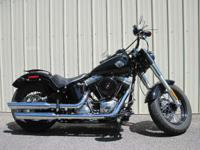 The Softail FLS sports blacked-out features and raw