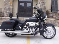 This bike has lots of cool Harley Davidson extras that