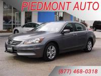 This Accord is loaded with heated seats and leather!