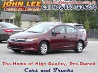 ONLY 65,184 MILES..! This 2012 Honda Civic LX has Cloth
