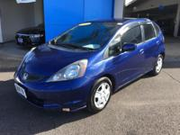 This 2012 Honda Fit is offered to you for sale by Big