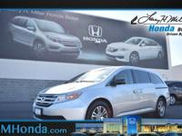 Snag a score on this certified 2012 Honda Odyssey EX