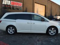 This 2012 Honda Odyssey Touring features a 3.5L V6