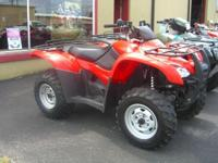 This ATV is four wheel drive and has automatic shift