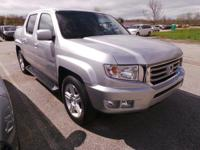 Come see this 2012 Honda Ridgeline RTL. Its Automatic