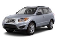 Climb inside the 2012 Hyundai Santa Fe! This is an