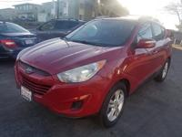One drive in our Garnet Red 2012 Hyundai Tucson GLS and