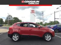 CARFAX One-Owner. This 2012 Hyundai Tucson GLS in Red