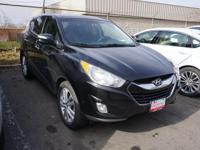 Very low miles, One Owner Q Certified Tucson.