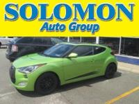 THIS 2012 HYUNDAI VELOSTER FEATURES A 1.6L I4,
