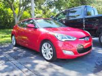 This 2012 Hyundai Veloster in Red Metallic features: