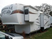 3 slides, electric awning, 4 new tires. Open concept
