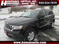 This 2012 Jeep Grand Cherokee Laredo with just under