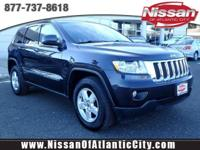 Check out this 2012 Jeep Grand Cherokee Laredo. Its