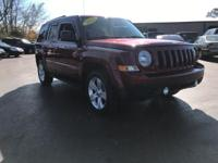This 2012 Jeep Patriot Latitude in Deep Cherry Red