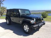 Just a beautiful Wrangler with Only 25000 miles. Brand