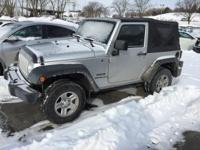 This outstanding example of a 2012 Jeep Wrangler Sport
