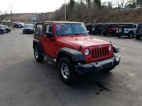 Come see this 2012 Jeep Wrangler Sport. Its Manual