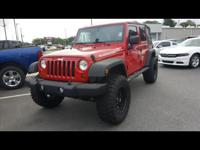 This Red 2012 Jeep Wrangler Unlimited Rubicon might be
