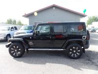 Options:  2012 Jeep Wrangler Unlimited Premium Audio!