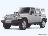 2012 Jeep Wrangler Unlimited Sahara CARFAX One-Owner.