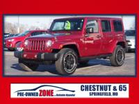 2012 Jeep Wrangler Unlimited Sahara in Deep Cherry Red