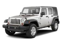 This 2012 Jeep Wrangler Unlimited Sahara 4WD features a