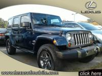 Climb inside this 2012 Jeep Wrangler Unlimited 4WD