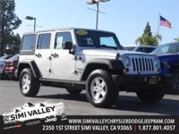 2012 Jeep Wrangler Unlimited Sport  Silver and 16 x 7.0