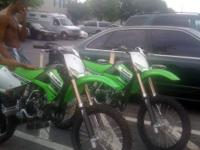 Brand new. 0 riding hours. Green /black. 2 stroke. 2