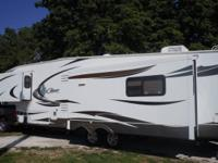 This 2012 Keystone Cougar 327RES is in excellent