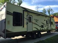 2012 Keystone Fuzion FZ300 toy hauler. Like new and