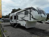 This 41' Fifth Wheel/Toy Hauler has tons of extras: