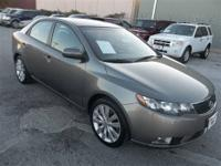 You must see this Gray 4 door Kia! This vehicle is
