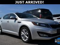 This Optima features: Bluetooth, Push Button Start,