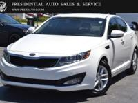 This 2012 Kia Optima 4dr LX features a 2.4L 4 CYLINDER