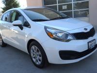 LX trim, Clear White exterior. FUEL EFFICIENT 36 MPG