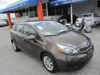 This 2012 Kia Rio 4dr EX Sedan . It is equipped with a