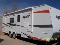2012 KZ MXT. Considered to be fully self contained it