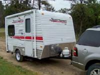 The Sportsmen Sportster 17 toy hauler travel trailer by