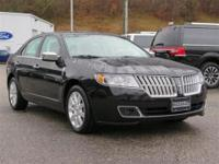 Racy yet refined, this 2012 Lincoln MKZ turns even the