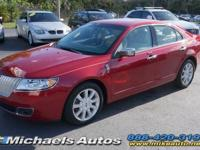 Call us at  about this Lincoln MKZ in Red Candy over