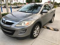 This outstanding example of a 2012 Mazda CX-9 Grand
