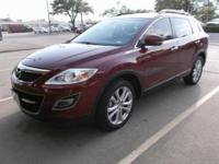This 2012 Mazda CX-9 Grand Touring is proudly offered